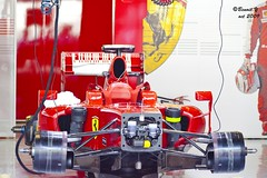 Scuderia Ferrari Marlboro Garage - Abu Dhabi Day 1 (OutFocus) Tags: red canon steering photos garage grandprix abudhabi spy brakes pitstop formula1 2009 kimiraikkonen scuderiaferrarimarlboro felipemassa mediapicture 5dmark2 yasmarinacircult