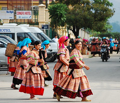 DSC_1421 Hmong women in traditional costumes (phuong.sg@gmail.com) Tags: travel people woman hat female rural festive asian costume colorful asia vietnamese village market folk decorative traditional hill chinese culture tribal vietnam clothes destination vendor merchandise tribe ornamental ethnic minority selling hmong peasant ethnicity touristic headdress mong indochina ethnography bacha