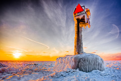 Sentinal of the Lake (jrobfoto.com) Tags: sunset sun lighthouse lake snow ice sign warning flickr michigan horizon clay hdr willard omot jonathanrobsonphotographycom viapixelpipe