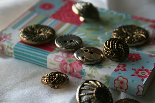 tiny notebook and buttons