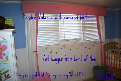 WINDOW PADDED VALANCE AND TIE BACKS WITH ART WORK HANGER UNDER NOTICE THE LADY BUG NIGHT LITE
