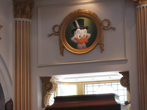 A portrait of Scrooge inside his store.