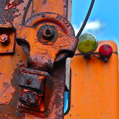 Orange, yellow, red (Chauncer) Tags: county old red orange abandoned minnesota yellow trash rural delete5 delete2 junk nikon rusty delete3 cable delete delete4 save equipment motor junkyard heavy pulley deserted steele owatonna grader d40