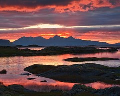 Sunset over Rum (Andrew Haynes Wildlife Images) Tags: sunset red sea orange mountains slr beauty yellow clouds canon fence reflections spectacular island scotland rocks dramatic atlantic lichen rum ripples westcoast 30d arisaig ajh2008