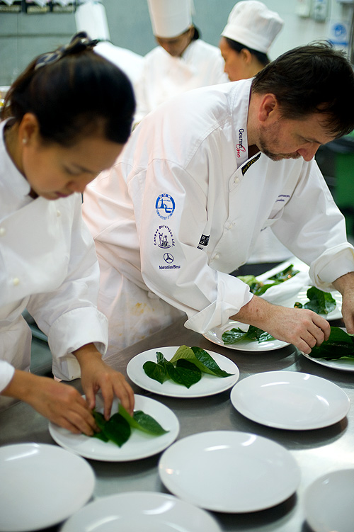 David Thompson and Ning Najpinij of Khao Cooking School in the kitchen during preparation for David Thompson's dinner at the Four Seasons Bangkok's World Gourmet Festival