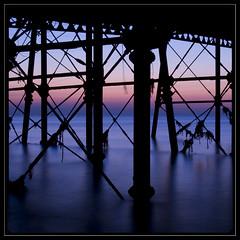 Sea Legs . (insomniac2008 .) Tags: longexposure sea silhouette canon eos dawn pier eastbourne eastsussex 400d