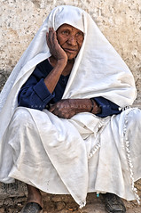 Contemplating (Khairy.ms) Tags: africa girl female women femme culture arabic explore arab tradition tribe jewels ethnic libya tripoli tribo libyan ghadames tribu arabo libia libye ghadafi   arabicart libyanman ribia liviya khadafi  libija    libyana     lbija  lby libja livi  libyanwomen  frashya libyaart