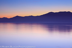 Minimalist Sunset, Salton Sea (CA) (Robin Black Photography) Tags: california blue sea sky lake mountains bird water silhouette landscape interestingness still cool twilight sand long exposure desert dusk decay ngc north salt environmental explore national shore zen hour disaster almost meditation minimalism hazy minimalist sanctuary dreamscape nationalgeographic alkali salton explored singhray outdoorphotographer canon5dmarkii robinblackphotography