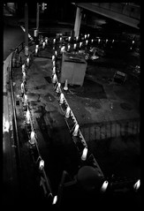 Shadows (gullevek) Tags: street light shadow blackandwhite rain japan night lights tokyo fuji cone 日本 東京 iso1600 モノクロ 汐留 雨 中央区 olympusom2n fujineopansuperpresto1600 epsongtx900 zuikomc28mmf2 geo:lat=35666362 geo:lon=139762423