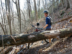 Mat hauling his bike over down trees (Mat and Amie) Tags: mountainbiking northmillsriver traceridge