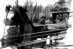 L'hors-la-loi (ici et ailleurs) Tags: texture 120 film analog self mediumformat graffiti blackwhite experimental photographer cowboyhat paintbrush kodaktmax400 mamiya645 bamf mofo trainbridge justforfun grandrapidsmi selfdeveloped