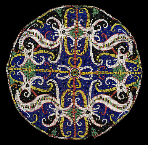 //Bead Panel,// Bahau people. Borneo 20th century, diameter 38 cm. From the Teo Family collection, Kuching. Photograph by D Dunlop.