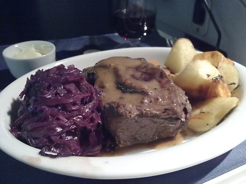 Slowly braised beef short rib with red wine braised cabbage and roasted rosemary potatoes