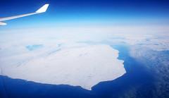 arctic blues (Xuan Che) Tags: ocean travel blue sea sky sun sunlight white canada ice landscape island frozen north azure aerial september arctic iceberg 2009 baffin