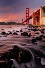 Golden Gate Bridge Sunset - San Francisco, California (Jim Patterson Photography) Tags: ocean sanfrancisco california longexposure travel bridge winter sunset sea sky seascape motion beach northerncalifornia clouds sailboat landscape bay coast pacific tripod shoreline landmark icon pacificocean coastal goldengatebridge shore lee goldengate coastline sanfranciscobay lowtide polarizer iconic sfbay travelphotography rockyshore landscapephotography remoterelease nikkor1224mm oceanscape nikond300 markinsm20 marshallsbeach beneathblueseas beneathblueseascom jimpattersonphotography jimpattersonphotographycom seatosummitworkshops seatosummitworkshopscom