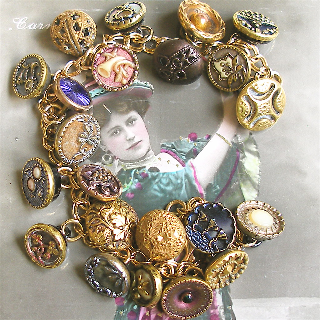 Gold charm bracelet with vintage Victorian buttons.