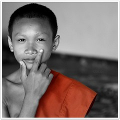 oo7....ORANGE (cisco ) Tags: portrait orange monk monaco explore cisco laos frontpage ritratto 007 donkhong champasak siphandon photographia theunforgettablepictures artofimages photographia bestportraitsaoi authorsclub