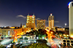 Partial San Antonio Skyline & The Friendship Torch* v2 (Jim | jld3 photography) Tags: street longexposure light urban cloud skyline night sanantonio marriott evening nikon downtown commerce cityscape image metro dusk garage parking trails clear blended metropolis nightlife grandhyatt traffice nightfall alamodome riverbend d300 rivercenter rivercentermall 800iso steaking freedomtorch friendshiptorch