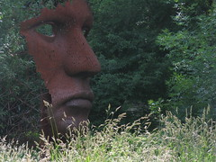 Face in the crowd (shaggy359) Tags: trees red sculpture green face grass statue blind expression profile blank stamford burghley