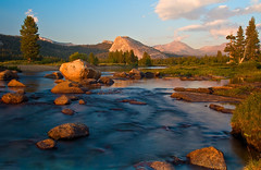 Tranquility along the Tuolumne (SheldonBranford (RichGreenePhotography.com)) Tags: california travel trees sunset summer sky usa mountains reflection silhouette clouds river nationalpark afternoon sundown sunny boulder valley dome yosemitenationalpark sierranevada tuolumnemeadows lembertdome tuolumneriver mtdana 0290 nikond200 thechallengefactory richgreenephotography
