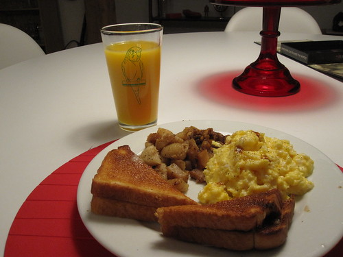 OJ, scrambled eggs, toast and potatoes sautéed in onions and duck fat - from groceries