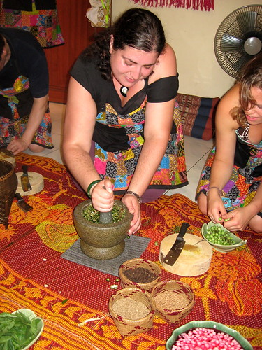 Making green curry in a mortar and pestle
