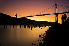 Eight Minutes of the Setting Sun (Jon Asay ) Tags: park bridge sunset silhouette st architecture oregon river portland long exposure arch cathedral gothic filter nd pilings johns willamette