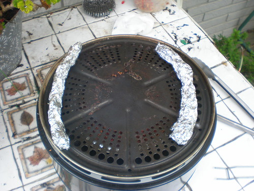 Cooking surface with aluminum foil spacers