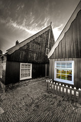 Looking in windows (Bas Lammers) Tags: wood bw house color reflection netherlands canon island paint fishermen monotone hdr marken ijsselmeer lightroom photoshopelements speia photomatix 50d mywinners markerwaard mygearandmepremium mygearandmebronze