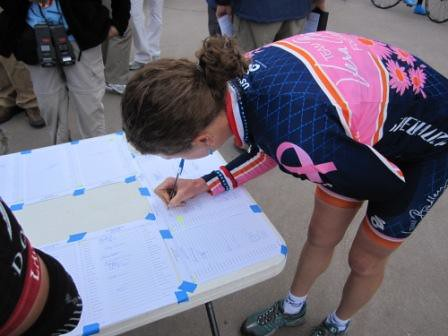 Team vera Bradley\'s Alison Powers signs in