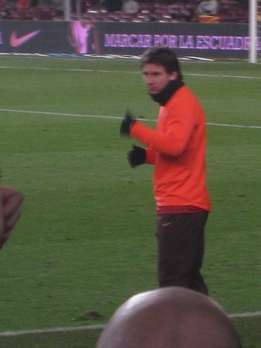 In the second half, Messi gives the thumbs up to the people shouting his name around me