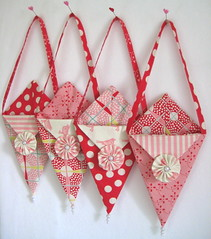Valentine Pennie Pockets (Happy Zombie) Tags: pink red sweet sewing moda craft valentine pearls fabric cotton valentinesday craftproject pennants yoyos goodiebags nosegay treatbag prairiepoints dingdongditch urbanchicks craftzinevdaycontest2009 modabakeshop wasfeaturedonexplore
