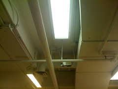 TEN:15. Looking up in  the waiting room. (revbean) Tags: pipes waitingroom ducts fluorescentlight ten15