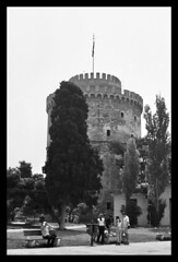 Summer in Thessaloniki (angelsgermain) Tags: city summer people tower waterfront greece thessaloniki benches makedonia thewhitetower abigfave flickrestrellas