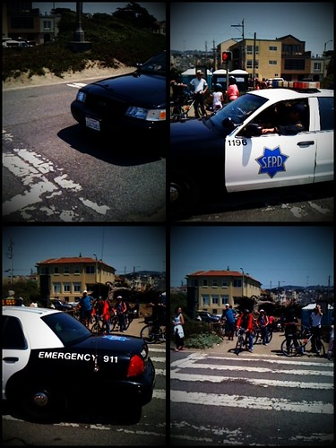 Police car going by as Sunday Streets ended by Steve Rhodes.