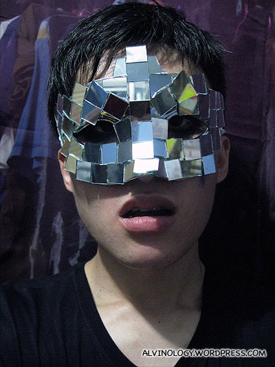 Completing the look with a mirror mask which Melvin made himself