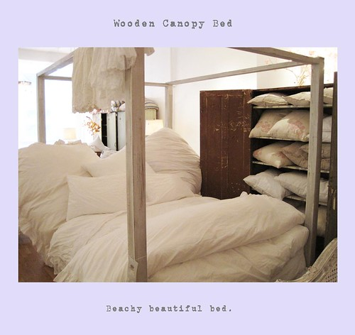 wooden canopy bed