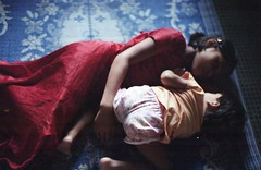 Behind the Curtains... (N A Y E E M) Tags: light availablelight daughter babysitter intimate whispers bangladesh chittagong rihanna basma leicar9 fujicolorsuperia1600 nayeemkalam summiluxr50mme60