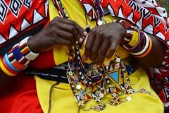 Masai Mara, Kenya - Think of all these hands do.... (ChellieL) Tags: masaimara safari masai africa red yellow travel trip holiday vacation woman colorful colourful kenya kenia nikon d3100 travelphotography challengegamewinner