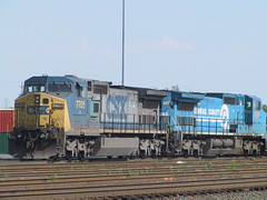 A CSX train, headed by a C40-8W No. 7705, followed by another C40-8W, still in Conrail paint, CSX No. 7329