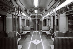 Old New York Subway Car (Tara Holland) Tags: blackandwhite bw newyork film underground subway print publictransportation metro postcard trix symmetry transportation symmetrical geometrical etsy subwaycar vintagesubway pentaxmx bwfilm vintagetransportation taraholland