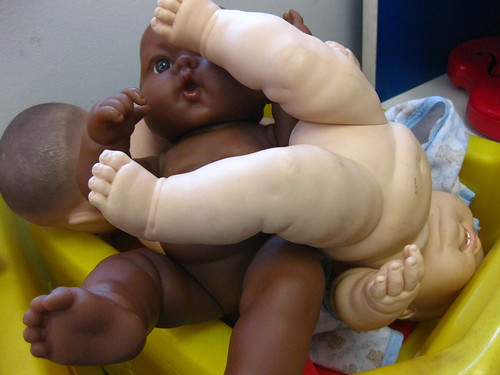 """why is the naked white baby oppressing the naked black baby?"""