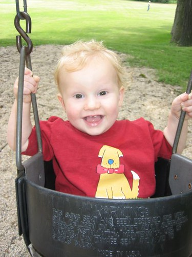 One year old on a swing.