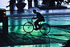 Roppongi Rain (samthe8th) Tags: storm reflection wet rain bike bicycle silhouette japan night umbrella japanese tokyo cool nikon moody cyclist traffic sam bladerunner accepted1of100 streetlife stormy hills starbucks rainy hero winner biker roppongi roppongihills 70200 mori mellow moritower summerrain cycler bigmomma d90 cool2 puddlereflection gamewinner cool5 cool3 cool6 cool4 seenonthestreet cy2 challengeyouwinner flickrchallengegroup flickrchallengewinner cool7 thechallengegame challengegamewinner iceboxcool cccunanimous unanicool samgellman ultraherowinner thepinnaclehof tphofweek3 fcgiconwinner shmedal fcgdone greenlanternoff