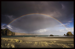 Whatipu Rainbow (Mark Emirali) Tags: ocean light sea cloud seascape texture water grass canon landscape rainbow sand air explore auckland nz frontpage 1022mm newzeland 30d copyrighted whatipu canon30d pleasedonotusewithoutmypermission maloe4 maloephoto maloephotography markemirali