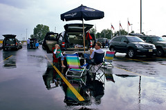 Tailgating for Bruce (Mike Dillingham) Tags: street family boy man reflection umbrella canon eos newjersey concert october stadium candid bruce parking band lot meadowlands e tailgate giants tailgating puddles 2009 springsteen canonefs1022mmf3545usm 40d