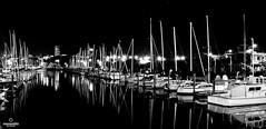 Westhaven Reflections (momentito) Tags: blackandwhite reflection water night canon boats mono calm auckland westhavenmarina momentito 400d kevinakers