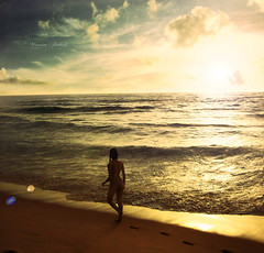 Here Comes the Sun (Nika Fadul) Tags: light sea woman beach water girl clouds sunrise walking waves flare sunflare monicafadul nikafadul
