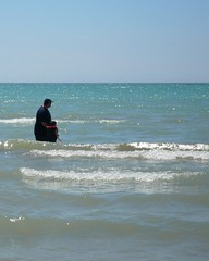 Geoffrey out in the surf (DNAMichaud) Tags: beach geoffrey sandbanks