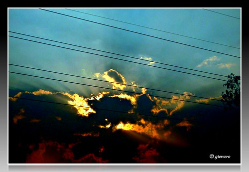 Explosión de color, sol,nubes,cielo. P1010703